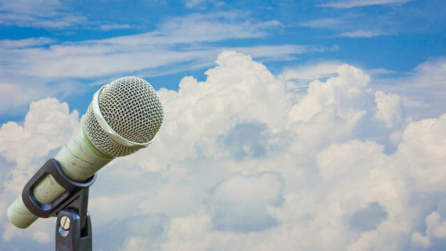 microphone with sky and clouds background
