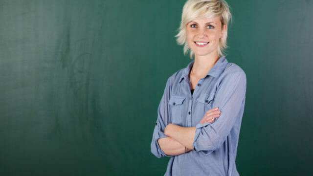 woman in front of chalkboard