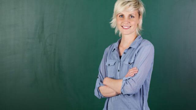 woman in front of chalkboard