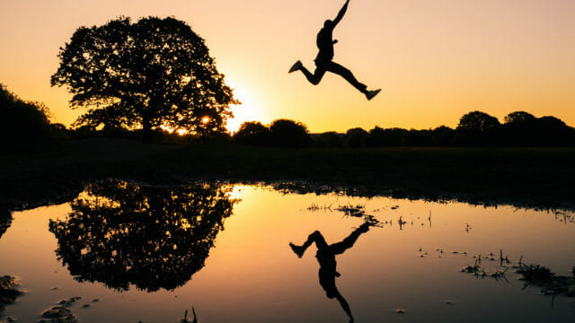 man jumping over water