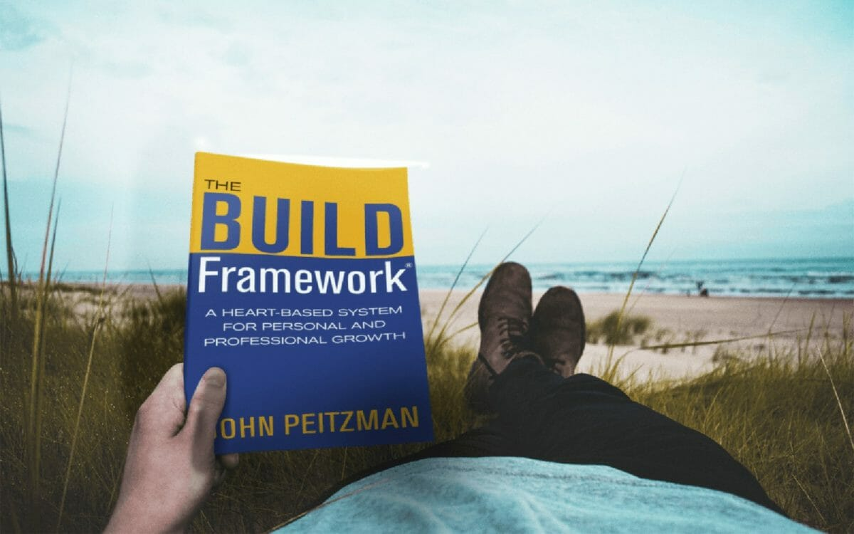man holding the build framework book