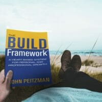 man holding the build framework book