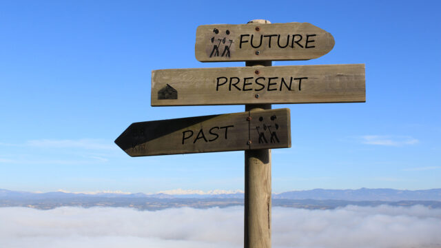 three signs indicating the way to future, present and past